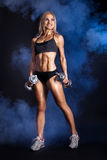 Female Fitness Model with dumbbells Stock Photography