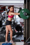 Female fitness model posing with weights Stock Photo