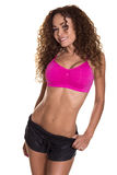 Female fitness model smiling. Toned fitness model flashes a perfect smile in her workout clothes Stock Images