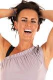 Female fitness model smiling pulling her hair back Stock Photography