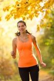 Female fitness model training outside and running Stock Images