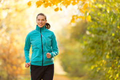 Female fitness model training outside and running Royalty Free Stock Photo
