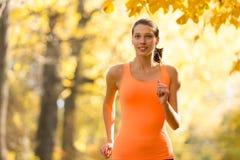 Female fitness model training outside and running Stock Photo