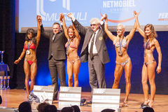 Female fitness models celebrate their victory on stage Royalty Free Stock Images