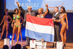 Female fitness models celebrate their victory on stage with offi Royalty Free Stock Image