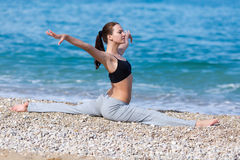 Female fitness on seashore Stock Image
