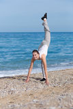 Female fitness on seashore Stock Photo