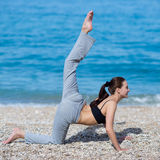 Female fitness on seashore Stock Photography