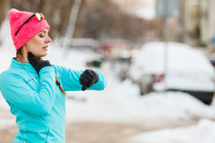 Female fitness sport model outdoor in cold winter weather Stock Images