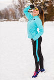 Female fitness sport model outdoor in cold winter weather Royalty Free Stock Images