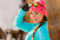 Female fitness sport model outdoor in cold winter weather Royalty Free Stock Image