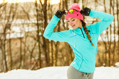 Female fitness sport model outdoor in cold winter weather Royalty Free Stock Photos