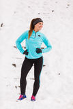 Female fitness sport model outdoor in cold winter weather Stock Photos