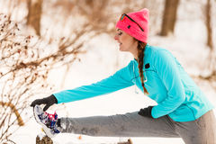 Female fitness sport model outdoor in cold winter weather Royalty Free Stock Photo