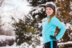 Female fitness sport model outdoor in cold winter weather Stock Photography