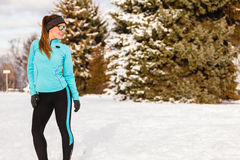 Female fitness sport model outdoor in cold winter weather Stock Photo