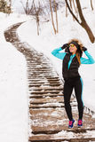 Female fitness sport model outdoor in cold winter weather Royalty Free Stock Photography