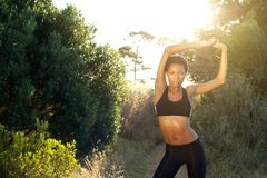 Female fitness sports model stretching outdoors Stock Photography