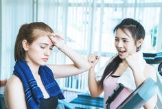 Female fitness trainer encouraging friend not to give up royalty free stock photos
