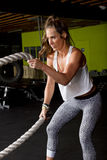 Female Fitness Trainer with Heavy Fitness Ropes Stock Images