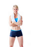 Female fitness trainer smiling to the camera with arms crossed Royalty Free Stock Image