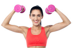 Female fitness trainer working out Royalty Free Stock Image