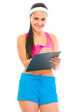 Female fitness trainer writing in clipboard Stock Photo