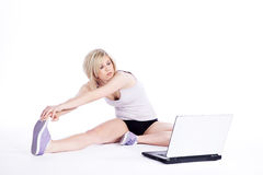 Female fitness and working on laptop Stock Image