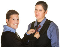 Female Fixing Tie For Spouse. Mature lesbian couple in blue shirts on isolated background Stock Photos