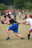 Female Flag Football Player Grabbed Stock Photos