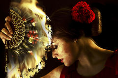 Female flamenco with fan on fire. Royalty Free Stock Photography