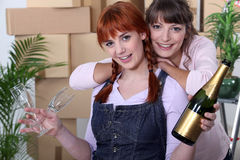 Female flatmates moving in Stock Photo