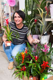 Female florist with bromelia plant Royalty Free Stock Image