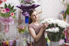 Female Florist With Bunch Of Flowers Royalty Free Stock Images