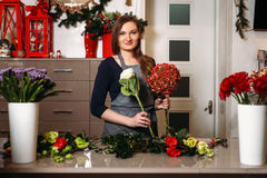 Female florist create beautiful bouquet Royalty Free Stock Images