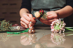 Female florist creating bouquet decoration closeup Royalty Free Stock Images