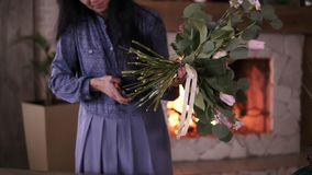Female florist cuts the stems of flowers in the bouquet. Woman in blue dress assembles a perfect bouquet. Final touches. You need to cut the stems before stock video