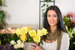 Female florist in flower shop Stock Photos