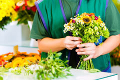 Female florist in flower shop Royalty Free Stock Images