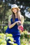 Female florist in the garden Stock Images