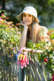 Female florist in the garden Royalty Free Stock Photo