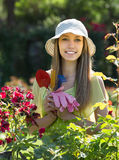 Female florist in the garden Royalty Free Stock Photography