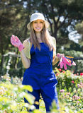 Female florist in the garden Stock Photo