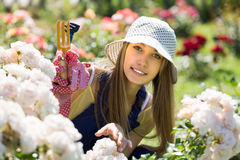 Female florist in the garden Royalty Free Stock Image