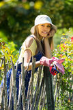 Female florist in the garden Stock Photos