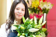 Female Florist holding a Bouquet Stock Photography