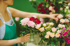Female florist making beautiful bouquet at flower shop Royalty Free Stock Images