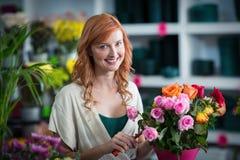Female florist preparing flower bouquet Stock Image