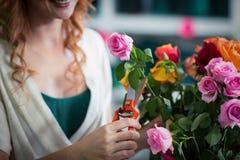 Female florist preparing flower bouquet Royalty Free Stock Images