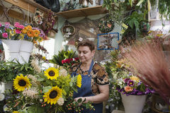 Female Florist In Shop Stock Photos